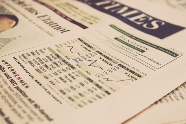 A financial newspaper, showing graphs of stock prices.