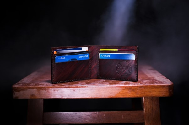A wallet standing open on a table, with credit cards visible