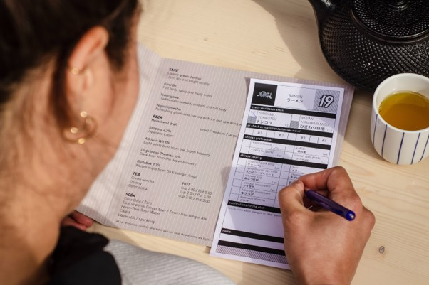 A woman filling out a form.